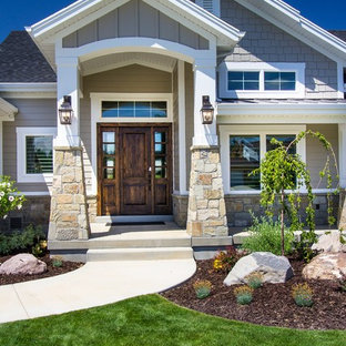 Inspiration for a mid-sized timeless beige two-story mixed siding exterior home remodel in Salt Lake City with a shingle roof