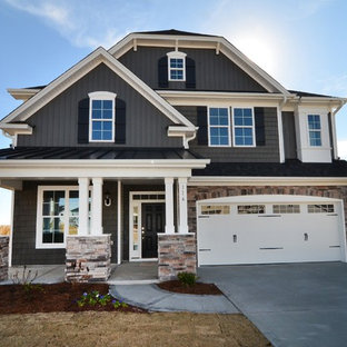 Large elegant gray two-story mixed siding exterior home photo in Raleigh