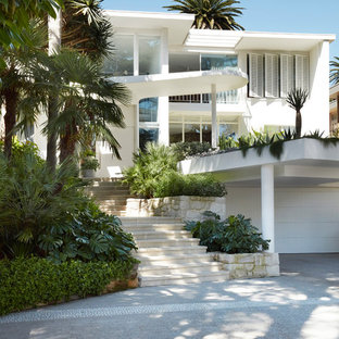 Inspiration for a modern two-storey white exterior in Sydney with a flat roof.