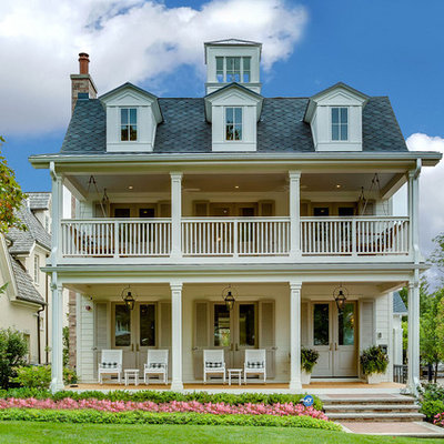 Traditional white three-story house exterior idea in Chicago with a shingle roof