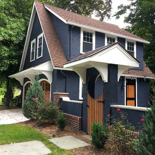 Inspiration for a small transitional blue two-story stucco exterior home remodel in New York with a mixed material roof