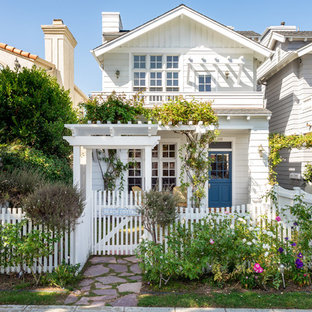 Example of a coastal white two-story exterior home design in San Diego with a shingle roof
