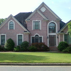 Traditional Exterior by MC Designs
