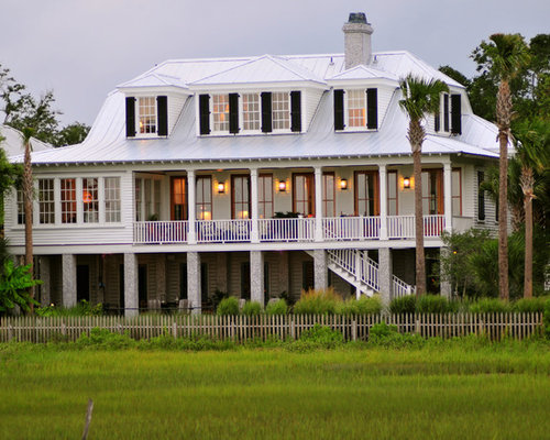 Inspiration for a tropical wood exterior home remodel in Charleston with a clipped gable roof and & Roof Dormer | Houzz memphite.com