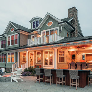 Coastal gray two-story wood exterior home photo in New York with a shingle roof