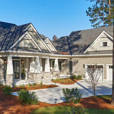 Inspiration for a large transitional gray two-story concrete fiberboard exterior home remodel in Atlanta with a hip roof