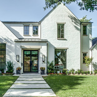 Inspiration for a huge modern white two-story brick gable roof remodel in Dallas