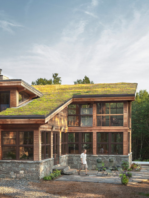 Example Of A Large Trendy Brown Wood Exterior Home Design In Portland Maine With Shed