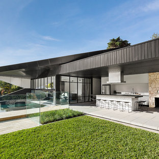 Inspiration for a contemporary one-storey black house exterior in Melbourne with a flat roof.