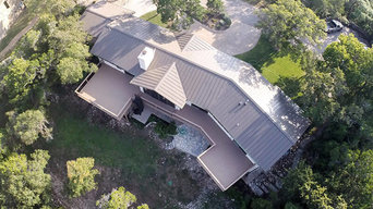 Home with Metal Roof & Deck Installation