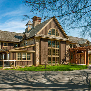 Inspiration for a cottage two-story stone gable roof remodel in Philadelphia