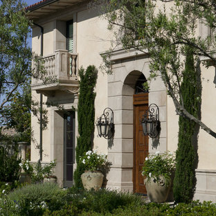 Example of a tuscan two-story exterior home design in Orange County
