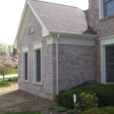 Traditional Exterior by Heartlands Building Company