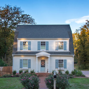 Cottage chic white two-story house exterior photo in Other