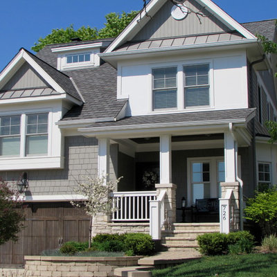 Mid-sized traditional gray two-story mixed siding exterior home idea in Chicago with a shingle roof