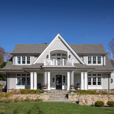 Elegant gray two-story wood exterior home photo in DC Metro with a shingle roof