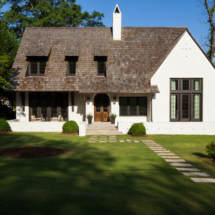 Mid-sized transitional white two-story brick exterior home photo in Birmingham with a shingle roof