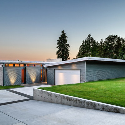 Small trendy gray one-story metal exterior home photo in Seattle with a shed roof