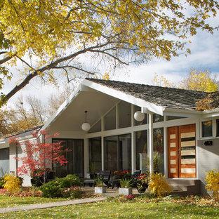 Midcentury modern gray one-story gable roof idea in Denver