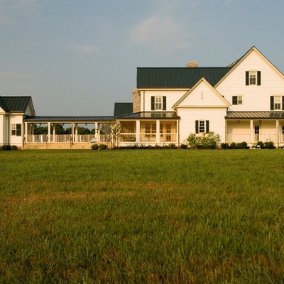 Example of a farmhouse wood gable roof design in Nashville