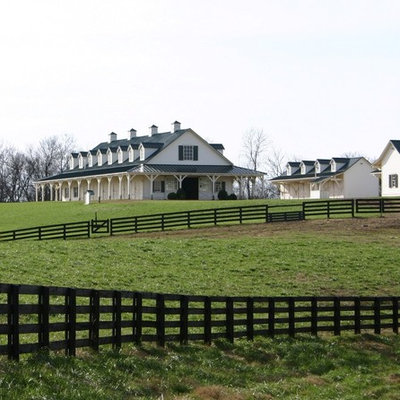 Example of a large cottage two-story wood exterior home design in Nashville