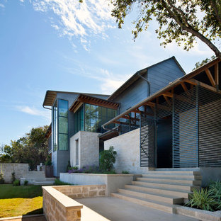 Huge transitional three-story metal gable roof idea in Austin