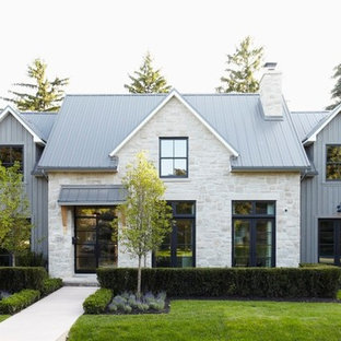 Mid-sized contemporary gray two-story mixed siding house exterior idea in Toronto with a metal roof