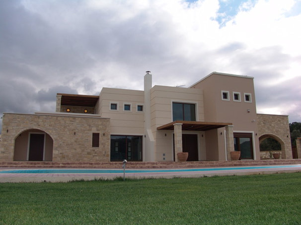 Mediterranean Exterior by NINOS CONSULTANCY CONSTRUCTION
