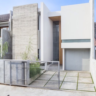 Idee per la facciata di una casa bianca contemporanea a due piani con tetto piano