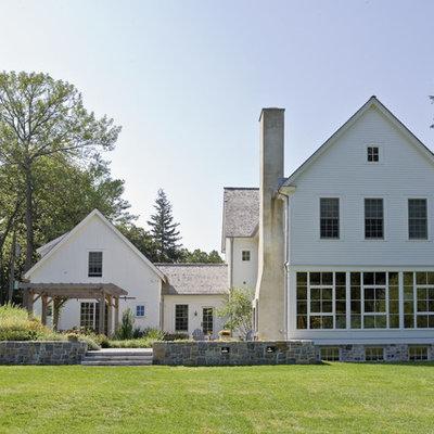 Farmhouse wood exterior home idea in New York