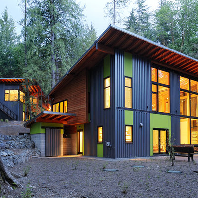 Large trendy multicolored two-story mixed siding house exterior photo in Seattle with a shed roof