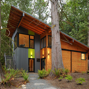 Example of a large trendy multicolored two-story mixed siding exterior home design in Seattle with a shed roof