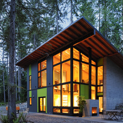 Inspiration for a large contemporary multicolored two-story mixed siding exterior home remodel in Seattle with a shed roof