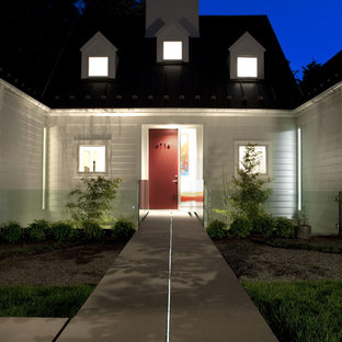 Large transitional white one-story house exterior idea in DC Metro with a metal roof