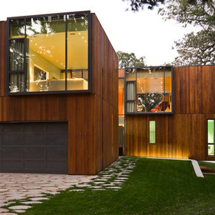 Large modern two-story wood exterior home idea in Omaha