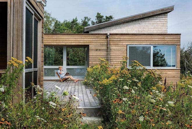Rustic Exterior by Elliott + Elliott Architecture