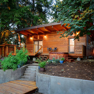 Rustic one-story wood exterior home idea in San Francisco