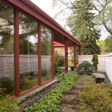 Midcentury Exterior by Genesis Architecture, LLC.