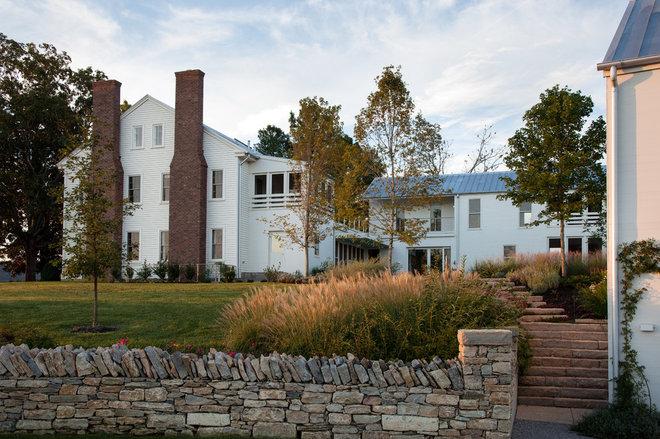 Farmhouse Exterior by HS2 Architecture