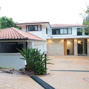 Photo of a contemporary two-storey white house exterior in Sydney with mixed siding, a hip roof and a tile roof.