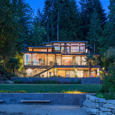 Inspiration for a 1960s three-story glass house exterior remodel in Seattle