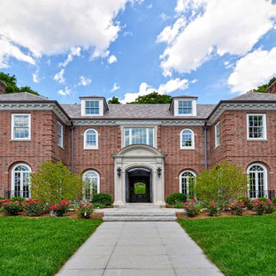 Huge elegant red two-story brick exterior home photo in Boston with a hip roof