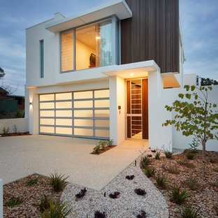 This is an example of a contemporary two-storey exterior in Perth with mixed siding and a flat roof.