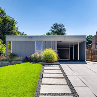 Photo of a modern one-storey grey house exterior in Denver with a flat roof.