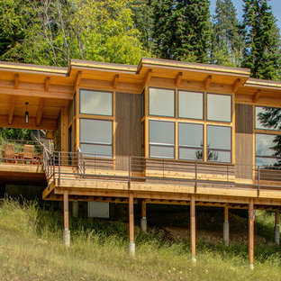 Inspiration for a mid-sized rustic brown two-story wood house exterior remodel in Seattle with a shed roof