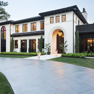 Inspiration for a mediterranean white two-story house exterior remodel in Minneapolis with a tile roof