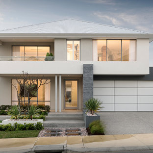 This is an example of a contemporary two-storey stucco multi-coloured house exterior in Perth with a hip roof and a metal roof.