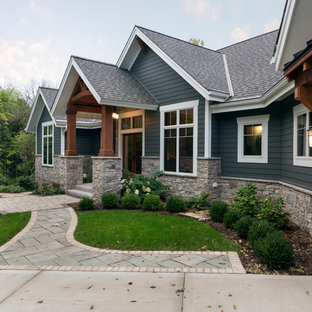 Example of a large arts and crafts blue one-story concrete exterior home design in Milwaukee with a shingle roof