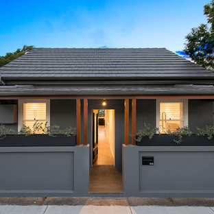 Inspiration for a contemporary one-storey grey house exterior in Sydney with a shed roof and a tile roof.