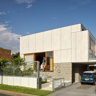 Design ideas for an industrial one-storey grey house exterior in Newcastle - Maitland with a flat roof.
